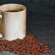 Cup of coffee and beans — Stock Photo #1986178
