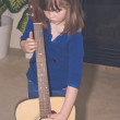 Little girl and big guitar — Stock Photo #1988212