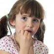 Little girl applying lip gloss — Stock Photo