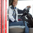 Pretty woman driving a big rig. — Stock Photo #1989930