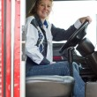 Stock Photo: Pretty woman driving a big rig.