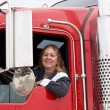 Woman driving an eighteen wheeler — Stok fotoğraf