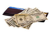 Small pile of American money on a wallet — Stockfoto