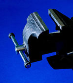 Vise on blue background — Stock Photo