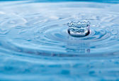 Water drop with red tint and crown shape — Stock Photo