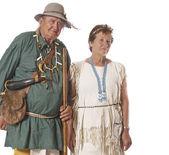 Happy couple in historic costumes — Stock Photo