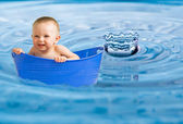 Baby floating in enlarged water photo — Stock Photo