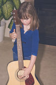Little girl and big guitar — Stock Photo