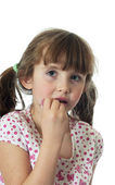 Little girl applying lip gloss — Stock Photo
