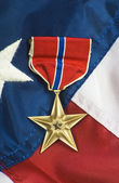 Bronze star on USA flag — Stock Photo