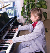 Young man preparing for a piano recital — Stock Photo