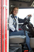 Pretty woman driving a big rig. — Stock Photo