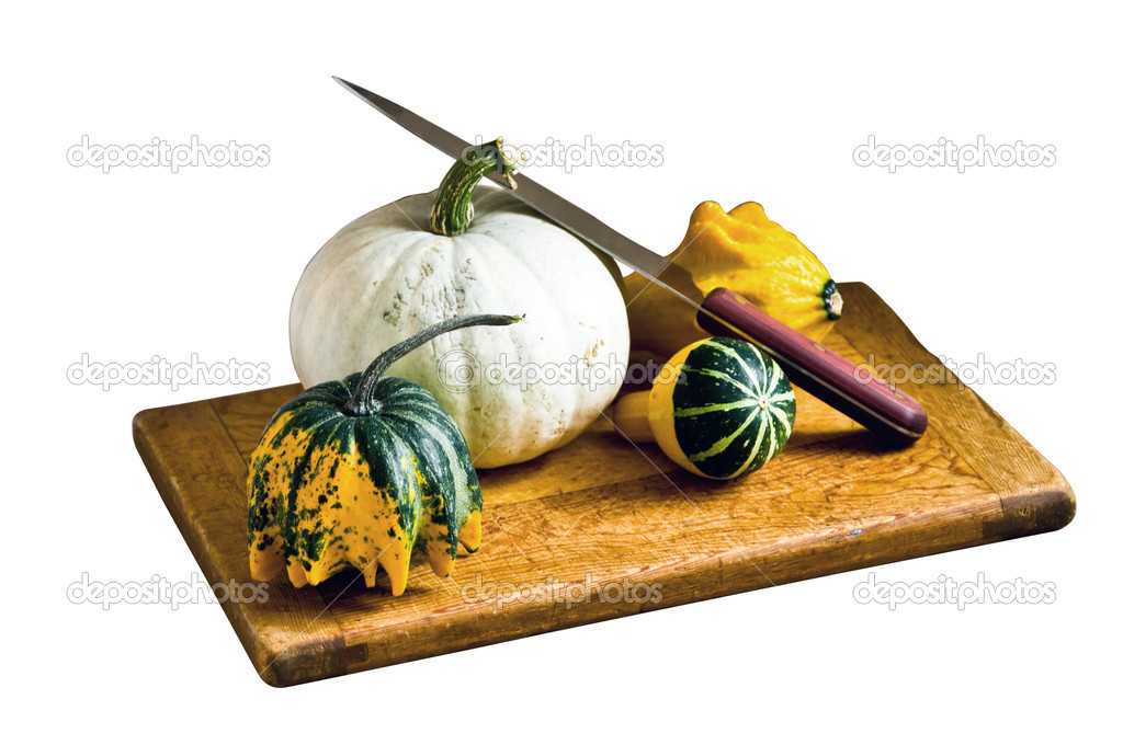 Gourds arranged on a cutting board with knife — Stock Photo #1984020