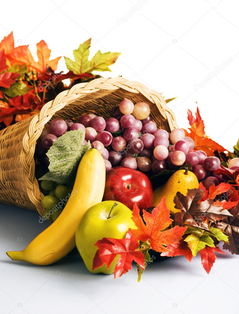 A wicker cornucopia filled with fresh fruit.  Stock Photo #1984214