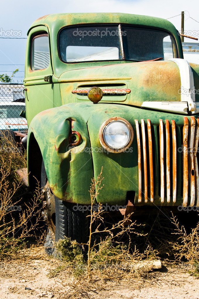 An old truck sitting in a junkyard  Stock Photo #1984445