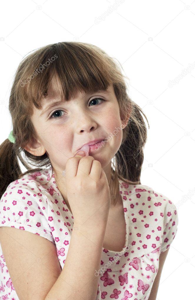 depositphotos 1988519 Little girl putting on lip gloss rollerblade girl