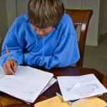 Teenager doing homework — Stock Photo