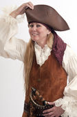 Pretty lady pirate adjusts her hat — Stock Photo