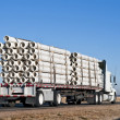 Semi-truck with a load of plastic pipe — Stock Photo
