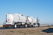 Big truck hauling crude oil — Stock Photo