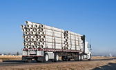 Semi-truck with a load of plastic pipe — Stockfoto
