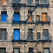 Stock Photo: Boarded-up Tenement Building