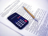 Calculator with pen — Stock Photo