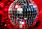 Mirror Disco globe - isolated on red — Stock Photo
