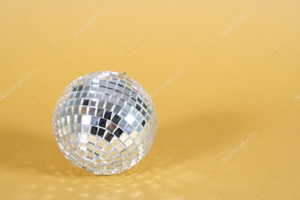 Christmas ball isolated on yellow background. — Stock Photo #1977338