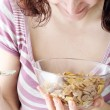Young eating milk with cereals — Stock Photo