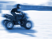 Close-up of a man driveing a quad — Stock Photo
