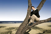 Girl in a tree — Stockfoto
