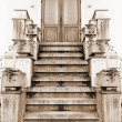Old entry in a house. Sepia - Stock Photo