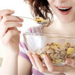 Young eating milk with cereals — Stock Photo #2548054