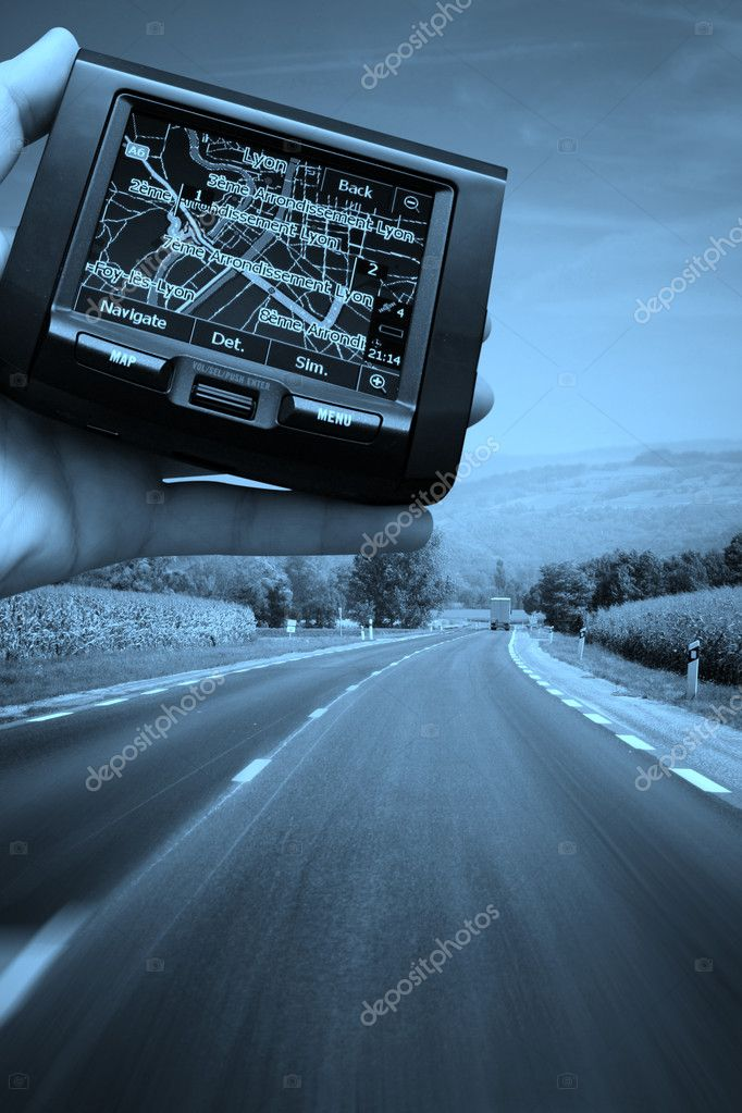 GPS Vehicle navigation system in a man hand. More of this serioes on my portfolio!  Stock Photo #2592254
