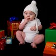 Baby Sitting Amongst Christmas Gifts — Stock Photo