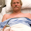 Man in Hospital Bed — Stock Photo
