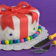 Fondant Gift Cake With Fork and Knife - Stock Photo