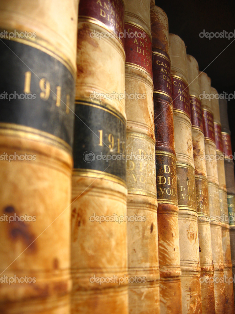 A shelf of vintage Canadian law books from the early 1900s.  Stock Photo #2345915