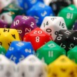 Stock Photo: Red Twenty Sided Dice in Mixed Group