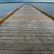 Old Dock Leading to Horizon - Stock Photo