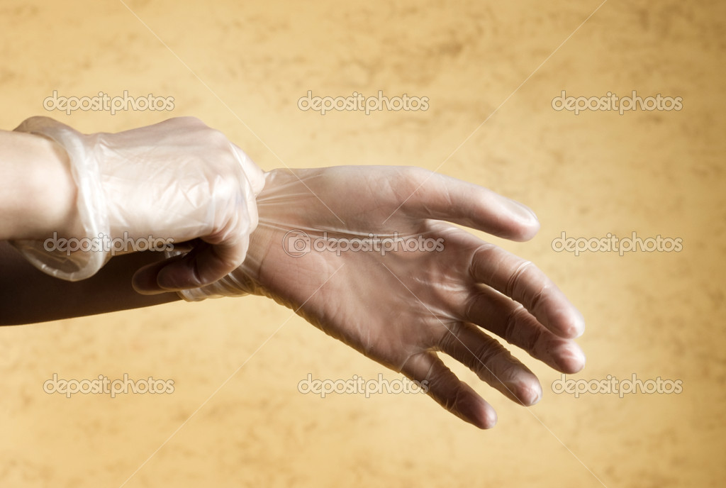 Hands putting on protective latex gloves — Stockfoto #1978516