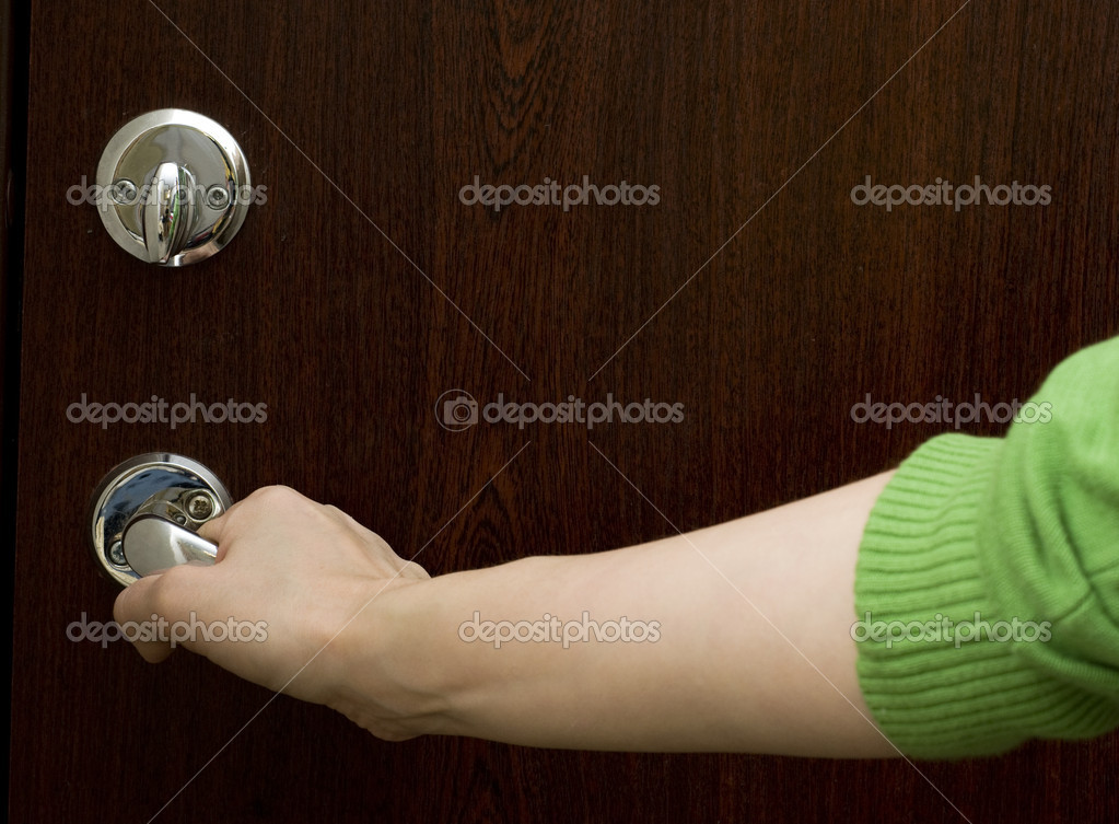 Hand on a handel opens or closes a door — Stock Photo #1978612