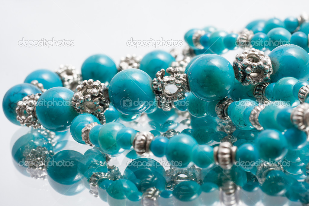 Turquoise beads with reflection  Stock Photo #2052210