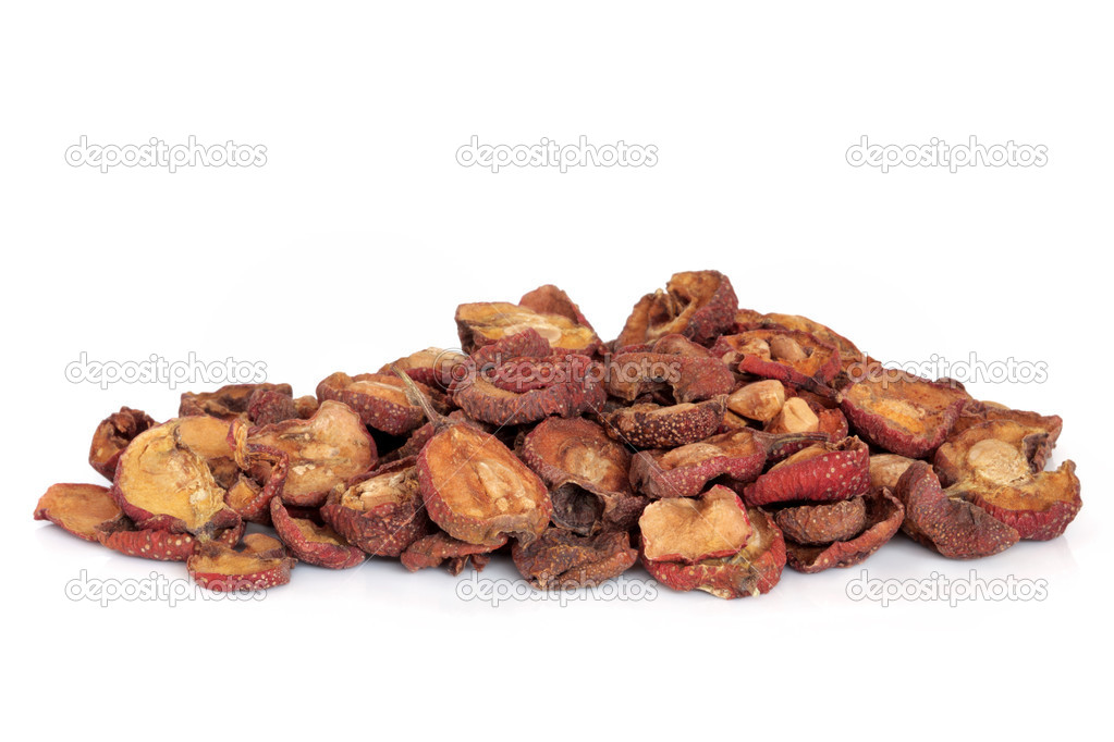 Dried hawthorn fruit used in chinese herbal medicine, isolated over white background. Shan zha, Fructus crataegi.  Stock Photo #1979621