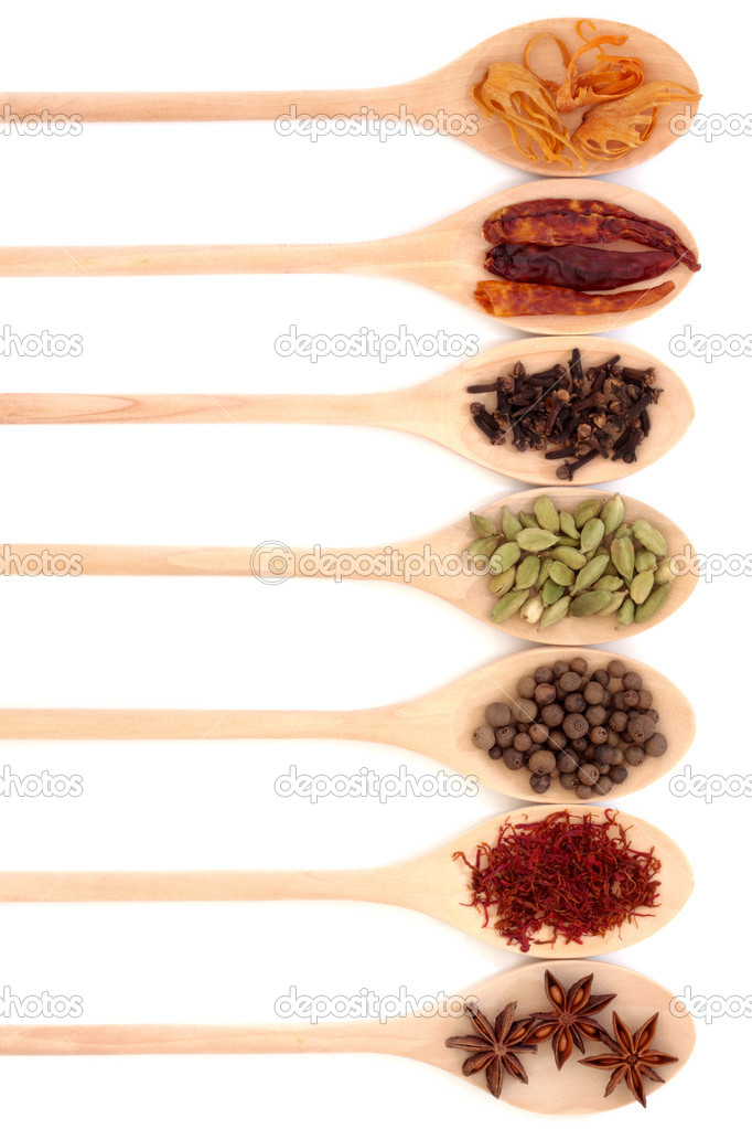 Spice collection in seven wooden spoons, isolated over white background. — Stock Photo #1986741