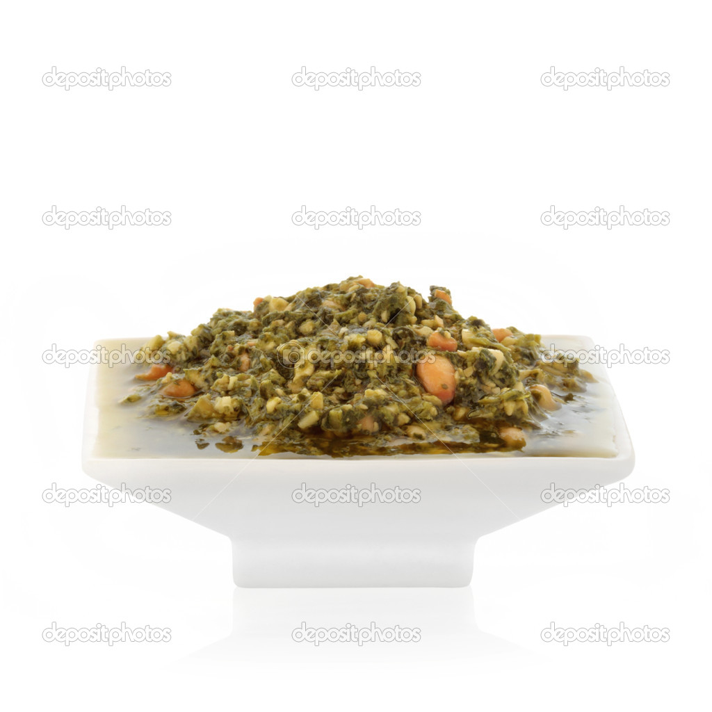 Pesto sauce in a white porcelain dish isolated over white background. — Stock Photo #1992004