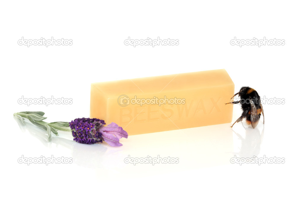 Beeswax, with a bumble bee and lavender herb flowers, over white background. — Stock Photo #2033119