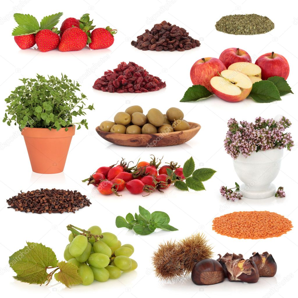 Healthy food collection of fruit, nuts, herbs and pulses, very high in antioxidants and vitamins, isolated over white background. — Stock Photo #2638649
