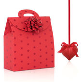 Red Gift Bag and Heart Shaped Bauble — Stock Photo